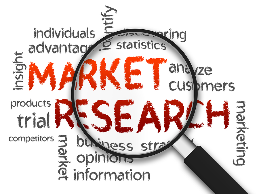 Magnified Market Research word illustration on white background.